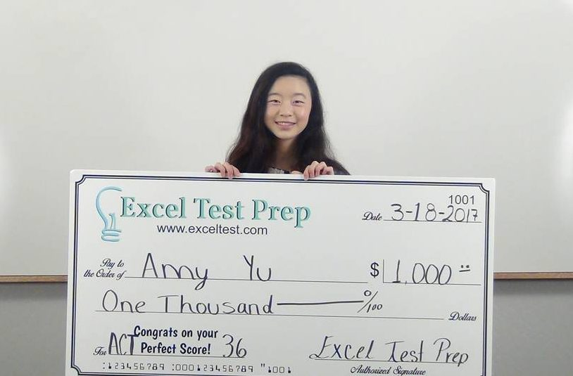Amy Yu is shown holding a large check for $1000. She is the most recent recipient of Excel Test's Perfect Score Scholarship by earning a perfect score of 36 on her December 2016 ACT exam.